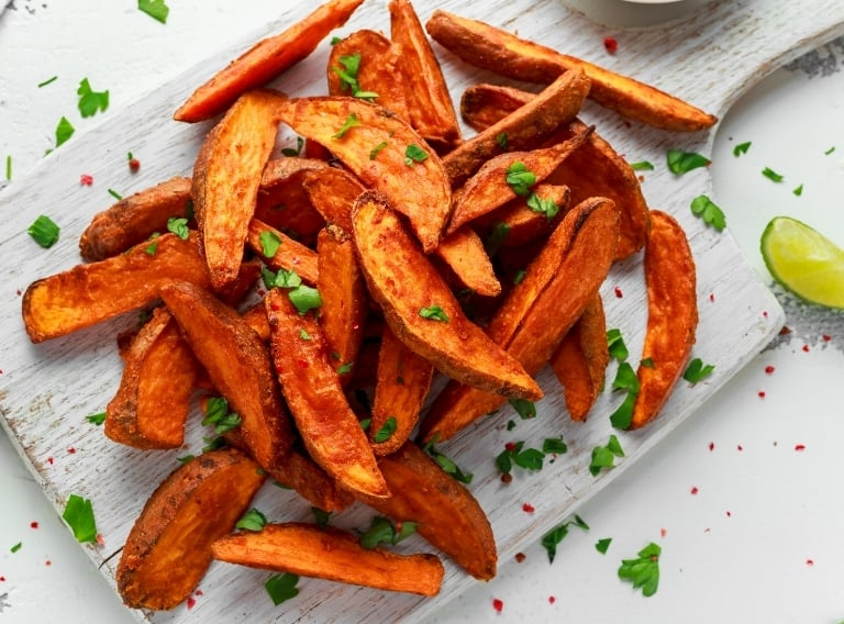 the best french fry cutter for sweet potatoes on a tray