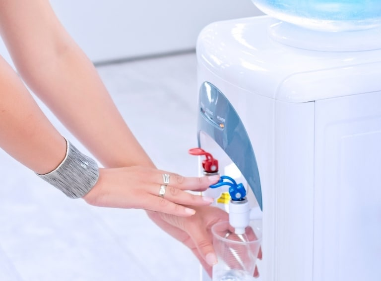 woman showing how to clean water cooler with vinegar