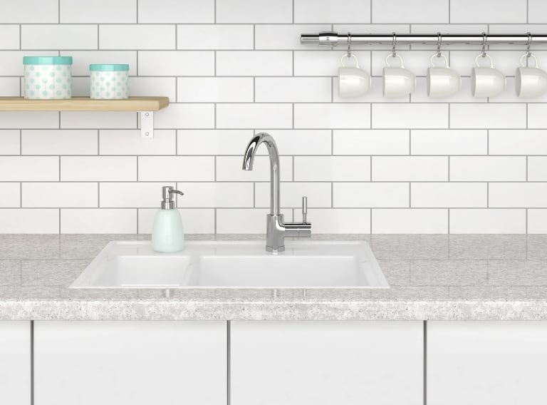 how to get rid of garbage disposal smell in this white sink