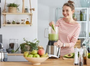 woman using the best personal blender for crushing ice